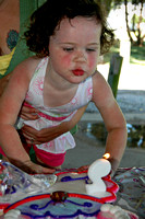 Hailey blowing out her candle